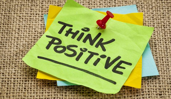 think positive  - motivational reminder - handwriting on sticky